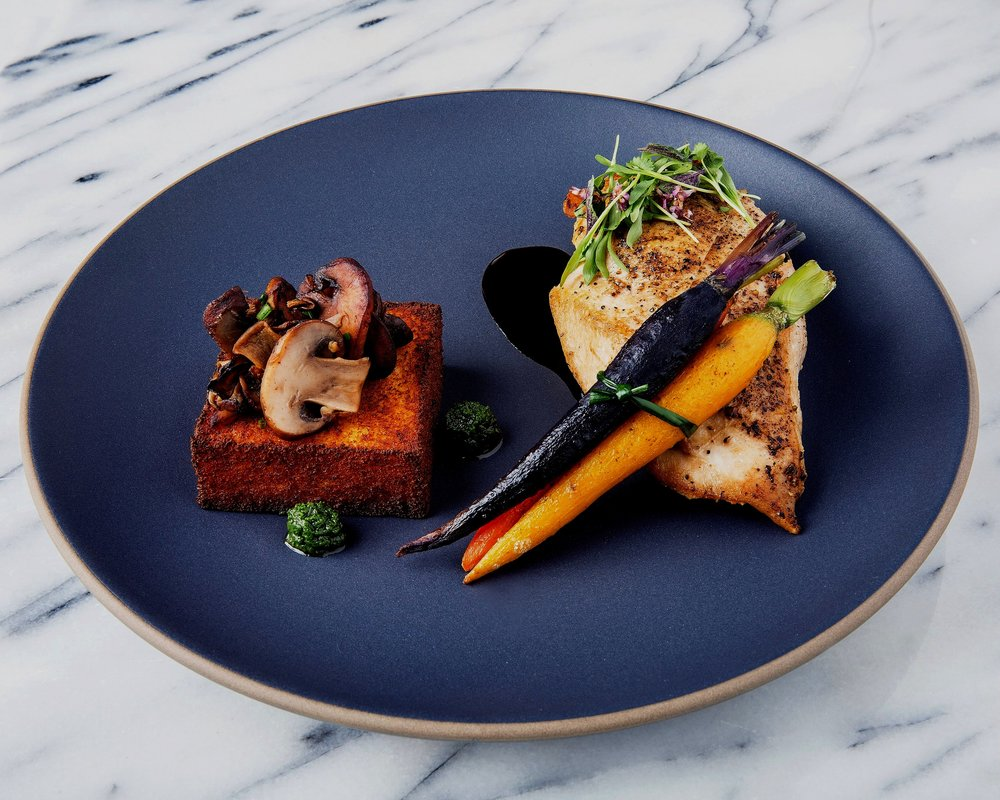 Roasted chicken with balsamic reduction with tricolor carrots and polenta with mushrooms
