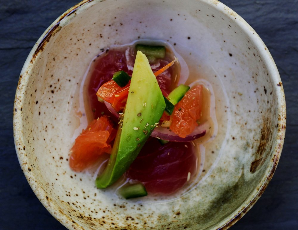 Ahi tuna ceviche with grapefruit, cucumber, avocado and red onion