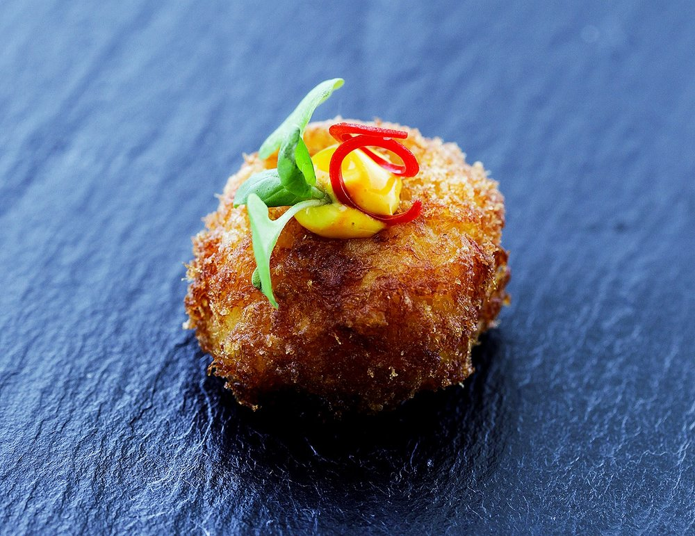 Croquette with aioli and anaheim chile and micro green