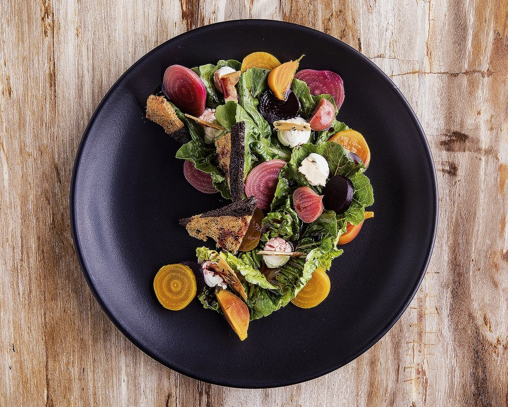Bibb salad with goat cheese, red and yellow beets, marbled toast and radish