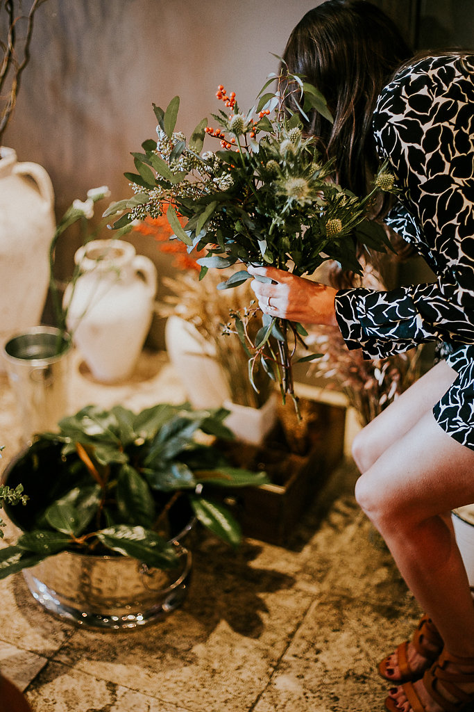 One of our 2016 workshop attendees gathering her elements to create a fall-inspired holiday wreath at our event co-hosted by the Junior League of the Emerald Coast. | Image by Kayla Nicole Photography