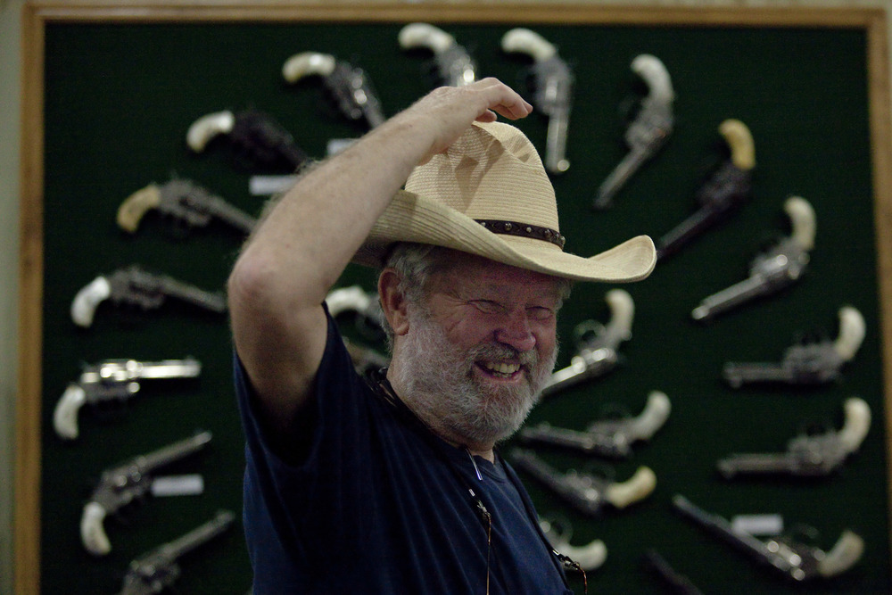 Kurt House, of San Antonio, TX, stands before his collection of factory engraved Colt pistols at the 2013 National Rifle Association Meeting and Exhibits May 2, 2013 in Houston. Factory engraved pistols are very rare and each one is worth about $50,000 by House's estimate. House is displaying his pistols with the Ohio Gun Collectors Association at the event.