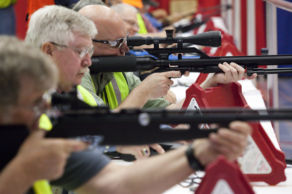 Volunteers sight air rifles at the Pyramyd Air air gun indoor shooting range at the 2013 National Rifle Association Meeting and Exhibits May 2, 2013 in Houston. Instructors were available for those willing to pay the $1.00 fee for five shots.