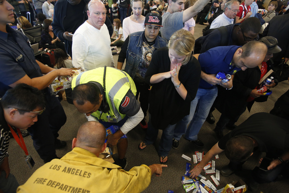 Los Angeles firemen dumped boxes of food on the carpet...