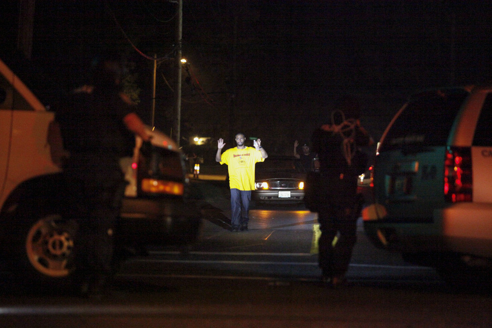 A man is directed toward police after shots were fired at law enforcement moments earlier.