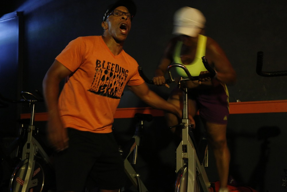 As protests take place two miles away, a spin class goes on uninterrupted August 19, 2014