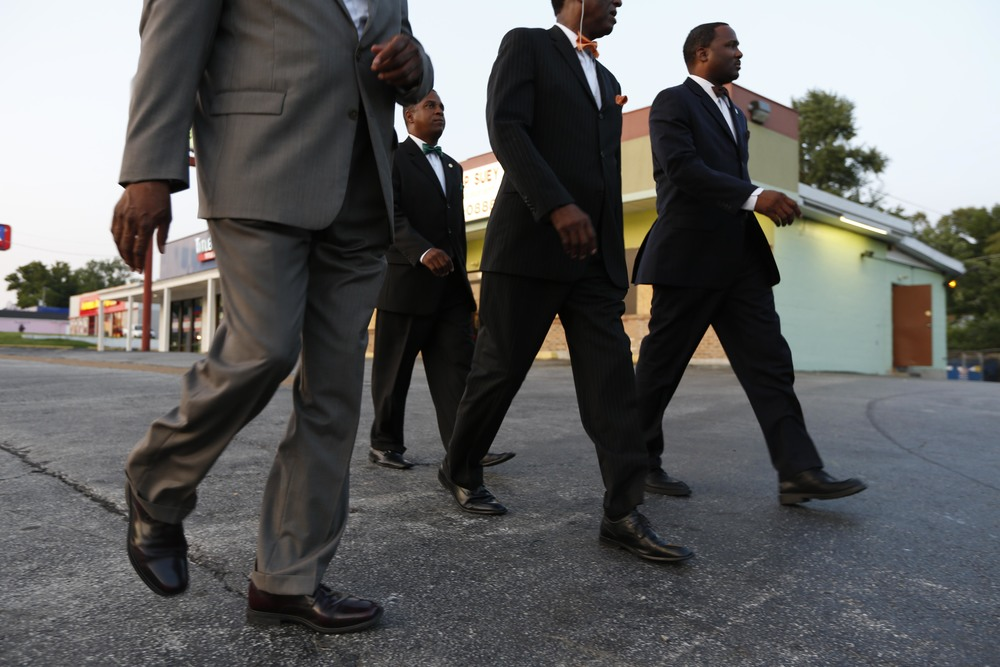 Members of the Nation of Islam walk down W. Florissant Ave. August 19, 2014 in Ferguson, MO.