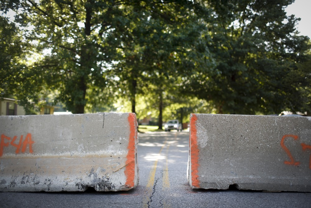 Road barriers stand at the end of Canfield Road, the same street Michael Brown was shot and killed on by a Ferguson police officer August 20, 2014 in Ferguson, MO. Some residents have complained that they're not able to get to their homes and don't know shortcuts that law enforcement presumes they know. Many cars were observed by the photographer driving through adjacent yards to get past the barriers with ease.