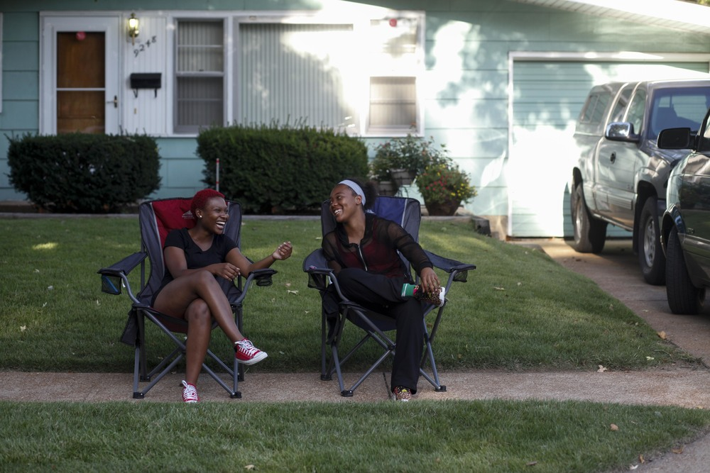 Markquetta Powell, left, and Deborah Austin chat on the sidewalk August 20, 2014 in Ferguson, MO. The two were chatting just around the corner from where Michael Brown was shot and killed by a Ferguson police officer.
