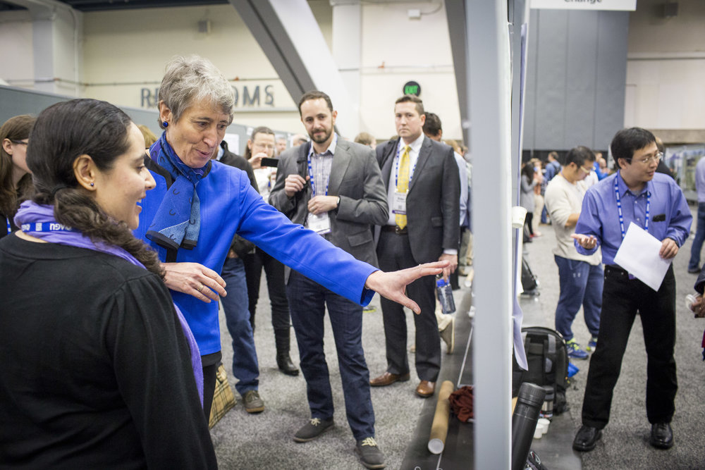 "Secretary of the Interior Sally Jewell speaks with Dr. Cericia Martinez, research geophysicist with the USGS, Wednesday, Dec. 14, 2016 in San Francisco, CA at the American Geophysical Union's annual fall meeting. Martinez's report is titled ""Quantifying potential future impacts of energy resource development."""