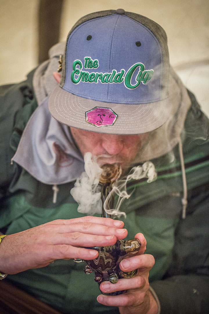 Zelly Rock takes a hit of weed inside a teepee  at the Emerald Cup.