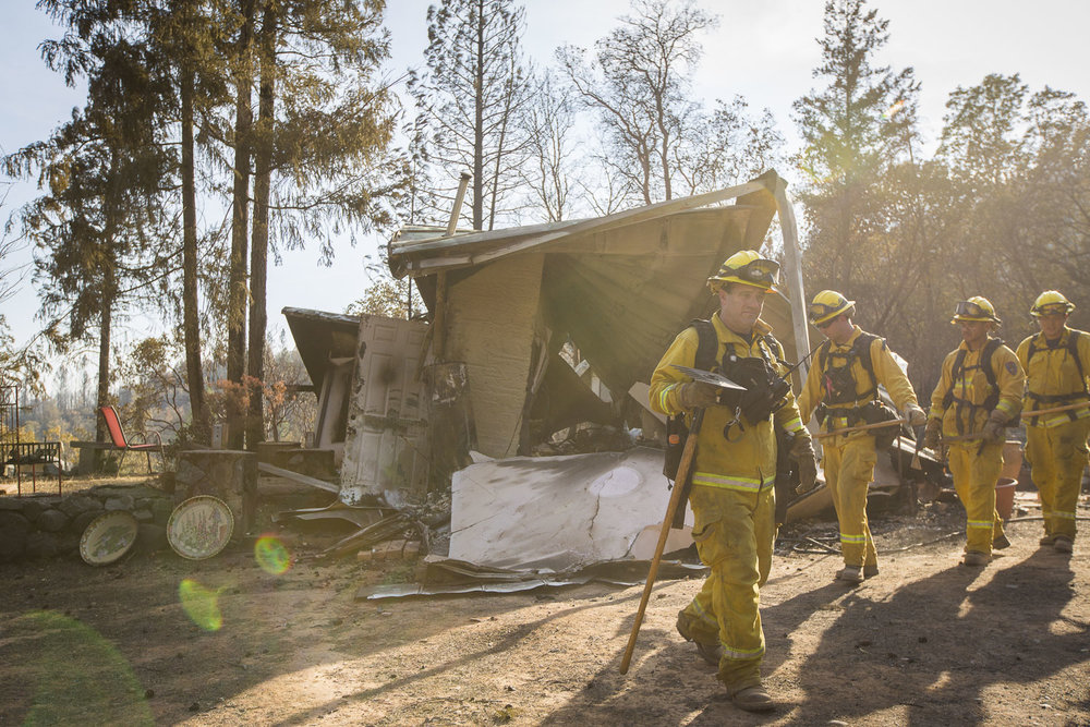 Firemen search for hotspots on Jan Hoyman's property destroyed by wildfire in a secluded neighborhood off Tomki Road Oct. 15, 2017 in Redwood Valley, CA.