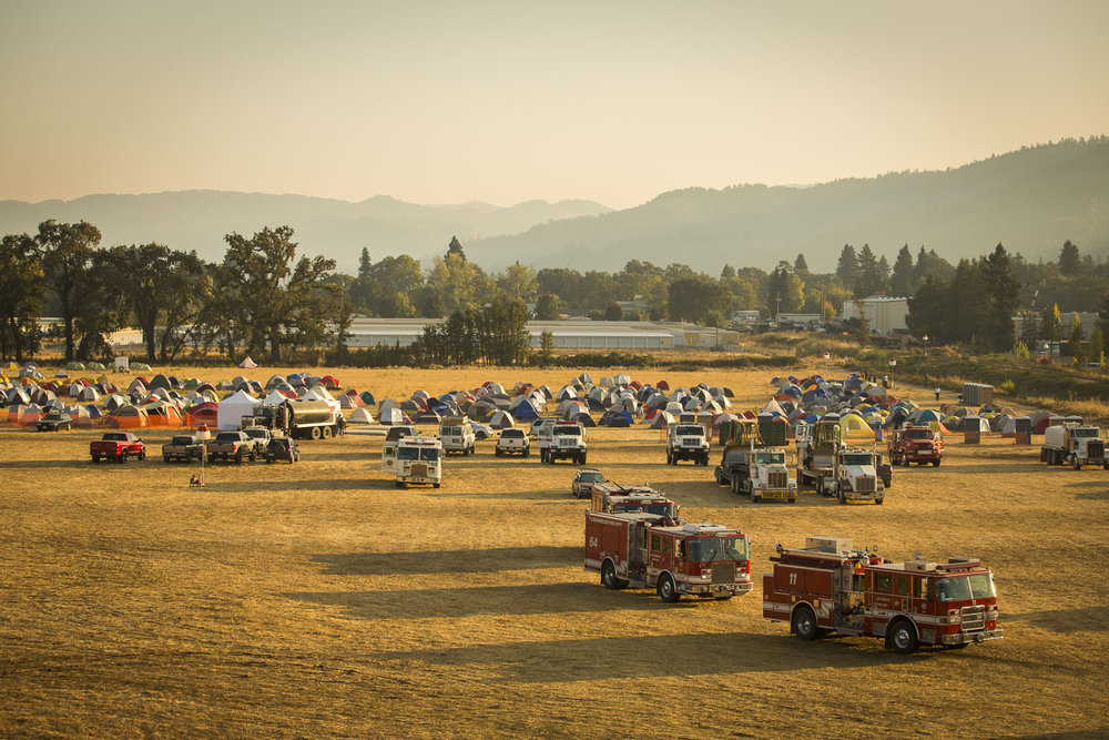 Firemen leave the Redwood Empire Fairgrounds Oct. 15, 2017 in Ukiah, CA. The fairgrounds were used as a staging area for fire officials.