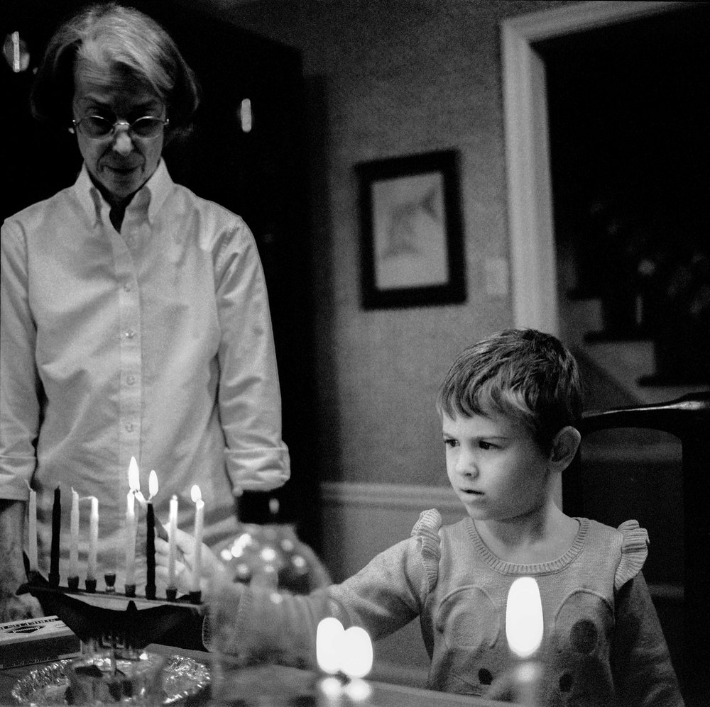 My daughter lights Hanukkah candles, Dec. 2017 in St. Louis, Missouri.