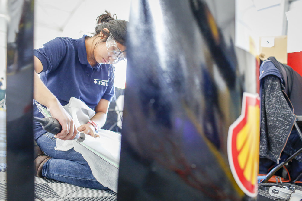 Team  #5,  University of Toronto Supermileage, of University of Toronto, in Toronto, Ontario, Canada, Prototype, Gasoline works on their car in the paddock during day one of Shell Make the Future at Sonoma Raceway, Thursday, April 19, 2018 in Sonoma, Calif.