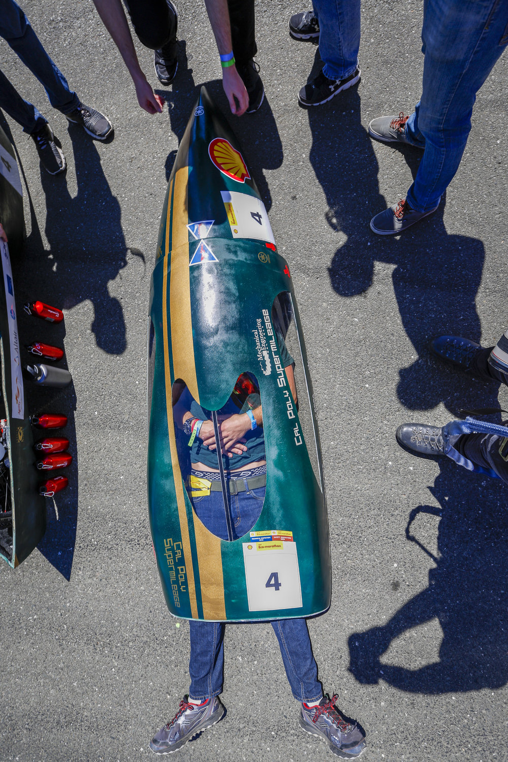 Team Cal Poly Supermileage with their vehicle the Donald Duck,  #4, from California Polytechnic State University, San Luis Obispo, CA, United States, competing under the Prototype - Gasoline category waits before a group portrait during day two of Shell Make the Future at Sonoma Raceway, Friday, April 20, 2018 in Sonoma, Calif.