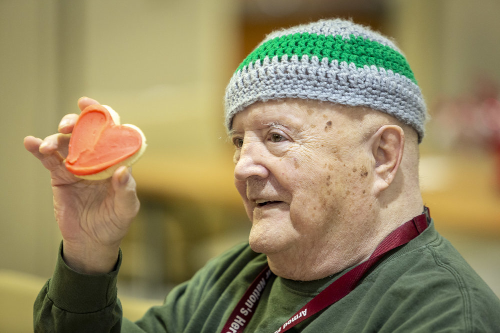A military veteran enjoys Cheryl's Cookies at the Armed Forces Retirement Home on Valentine's Day on Thursday, Feb. 14, 2019 in Washington, DC.
