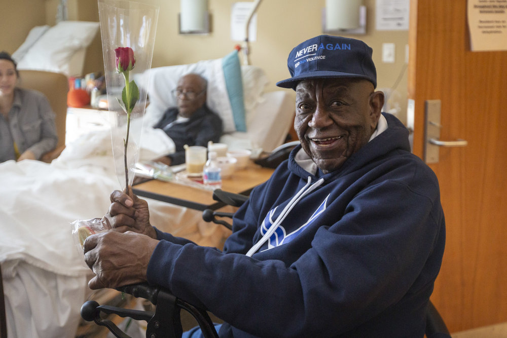 A military veteran receives a rose from 1-800-Flowers.com and a cookie from Cheryl's Cookies at the Armed Forces Retirement Home on Valentine's Day on Thursday, Feb. 14, 2019 in Washington, DC.