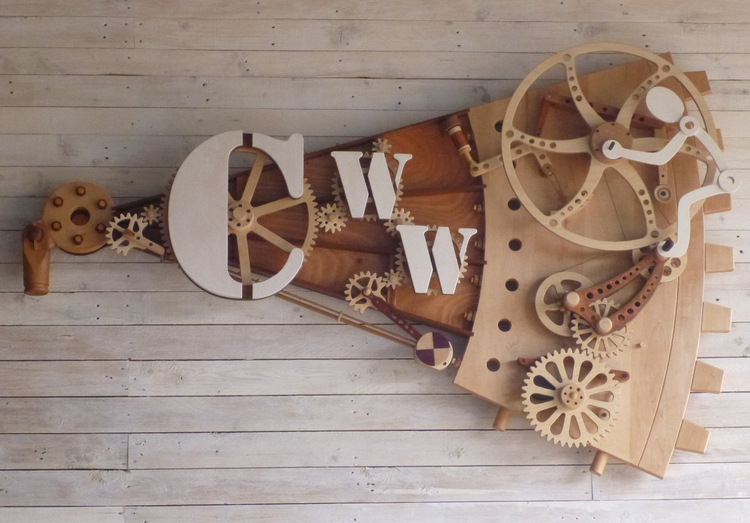 Upcycling in High Gear reclaimed wood kinetic sculpture
