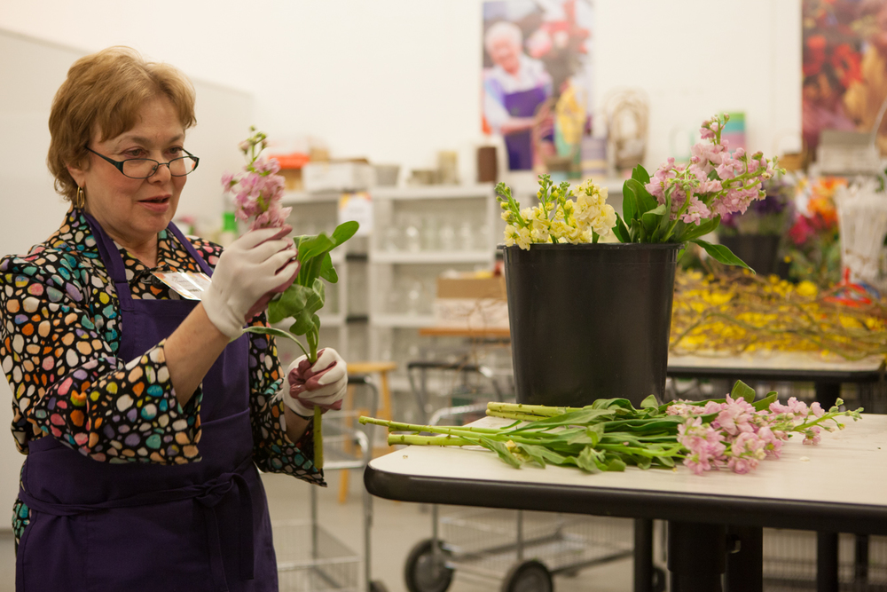 The volunteers sort the flowers and prepare them for arrangements.