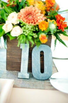 Wooden table numbers-blue stained, gold metallic and walnut stain  $3 each number  Photo:  Sharyn Peavey