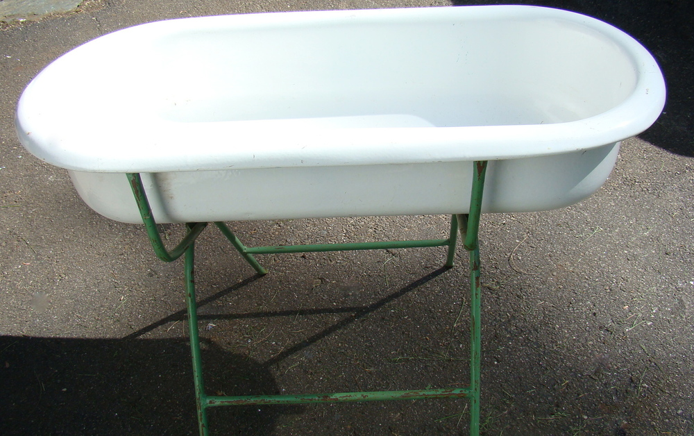 Vintage enamel cast iron tub on stand, great for raw bar or beverage tub   $75
