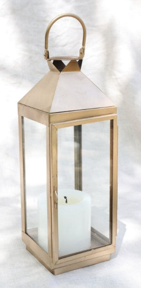 "Gold metal lanterns hold 3""x3"" or 3""x6"" pillar candle, 16"" Tall X 5.5"" square  $15 each"