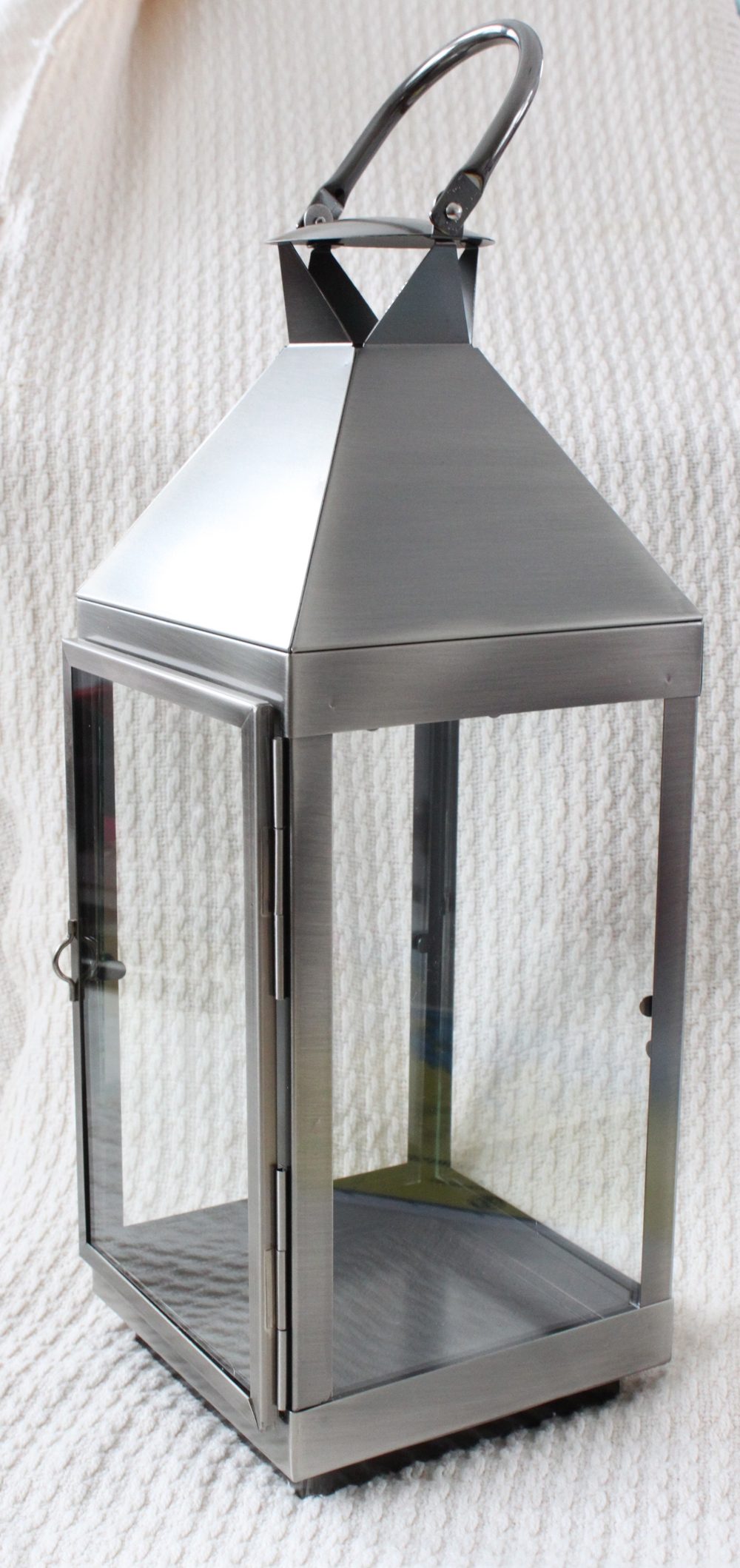 "Silver lanterns hold 3""x3"" or 3""x 6""   pillar 16"" tall x 5.5"" square  $15 each"