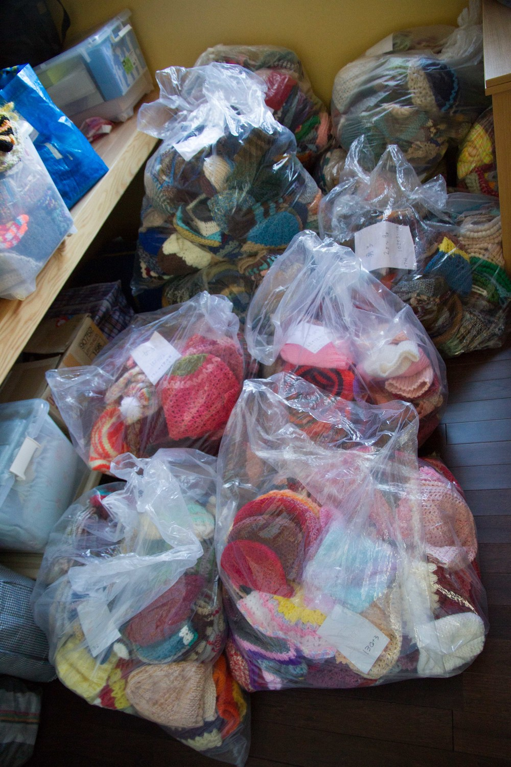 BAGS OF HATS WAITING IN STORAGE ROOM_ i would use this first before showing all the hats on display.jpg