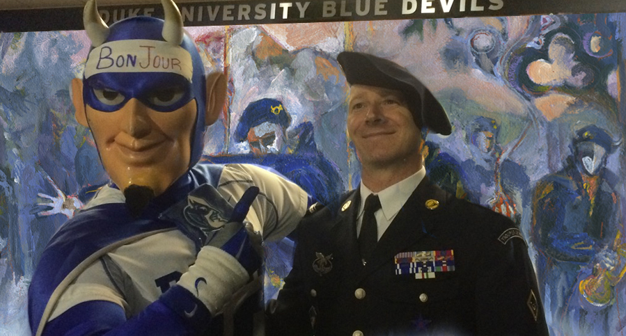Current Blue Devil Mascot meets senior enlisted NCO Major Lakomy of Les Diables Bleus standing in front of the 300 sq ft. Alpine Gothic installation by Revere La Noue.