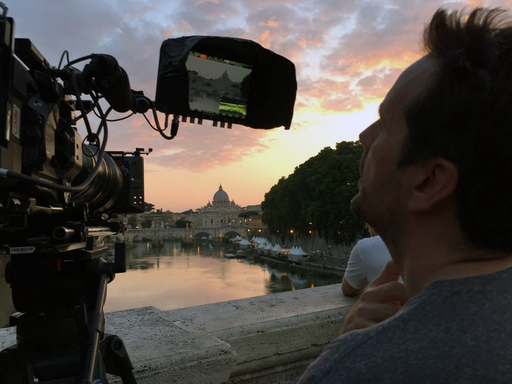 Revere La Noue filming sunset on the Tiber river.