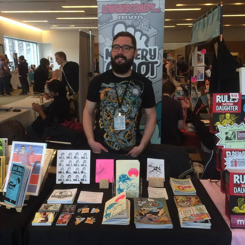 At TCAF hustlin' the comic wares