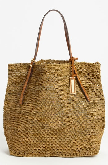 A chic straw tote like this one from Michael Kors.