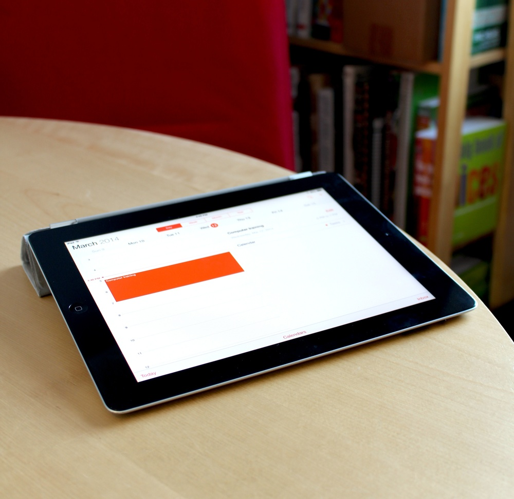 iPad on table with the Calendar app open.