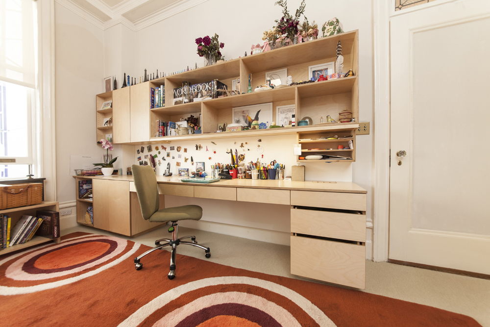 custom desk with storage drawers and shelving for children