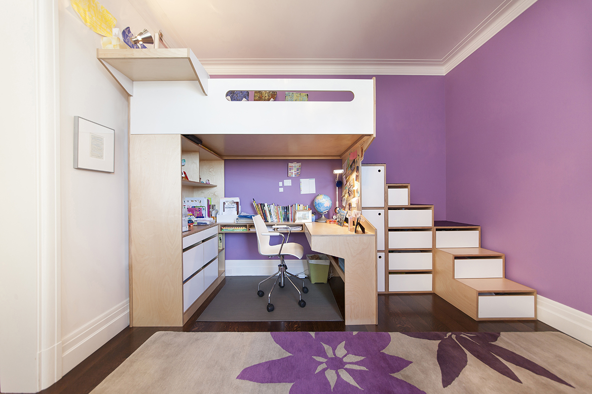 Loft bed with desk underneath. Purple accent walls