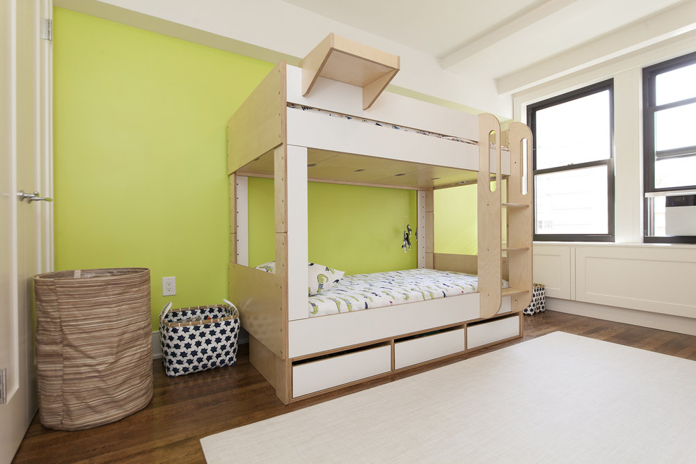 low bunk bed with storage cabin