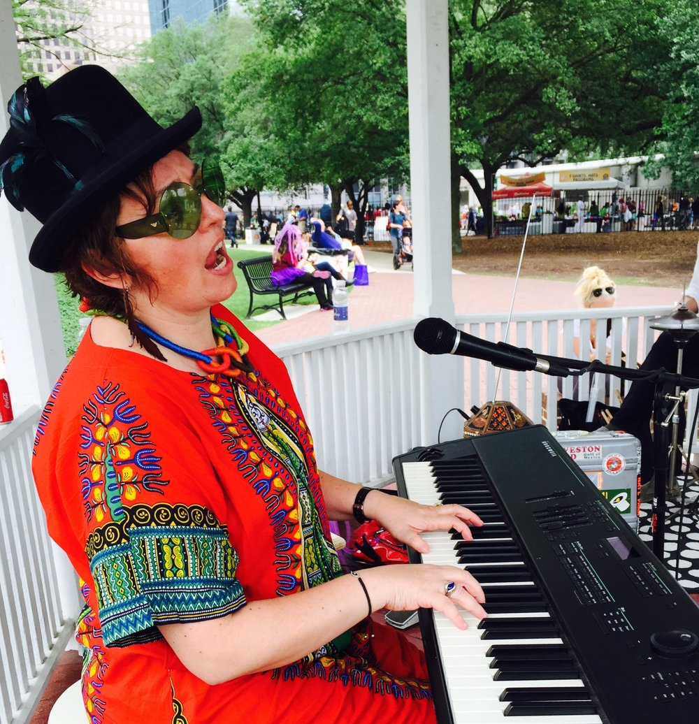 Loreta Kovacic performing at HOUSTON ART CAR PARADE Creative Kid Zone