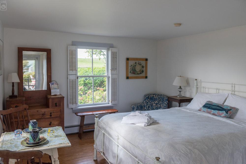 Room 6, one queen, garden and partial ocean views