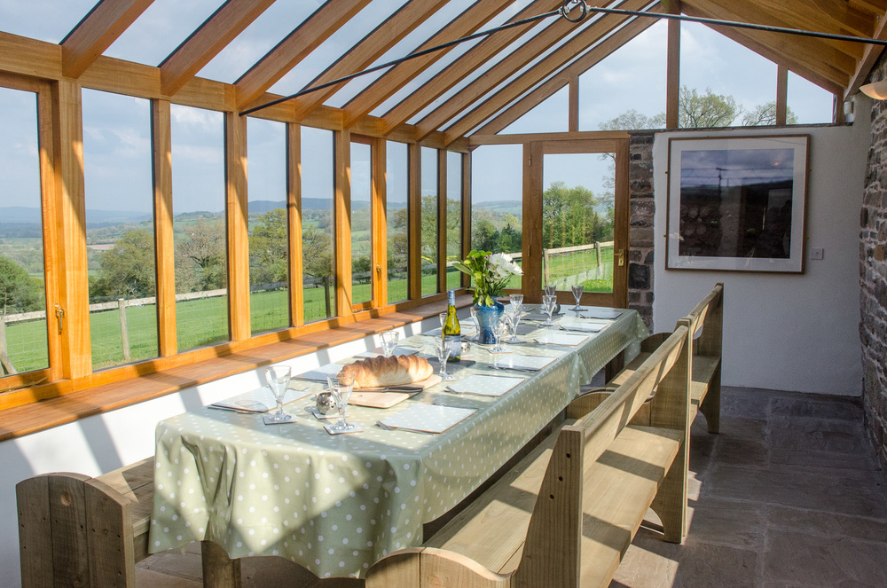 The conservatory has incredible views over the Wye valley