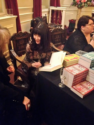 Essie Fox signing books for her readers.