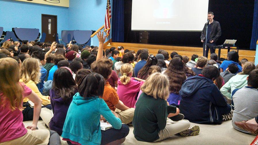 Rohan talking to kids at Harvard Elementary, Houston, Texas.