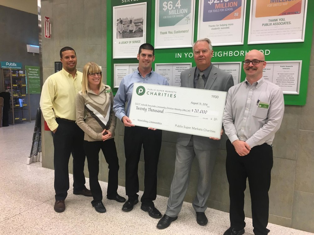 Reverend Scott Rogers, ABCCM's executive director (second from right) accepts a donation from Publix Super Markets Charities along with (left to right) David Yancy, grocery manager; Danielle Meyer, assistant customer service manager; David Jenkins, store manager; and Josh Surles, produce manager.