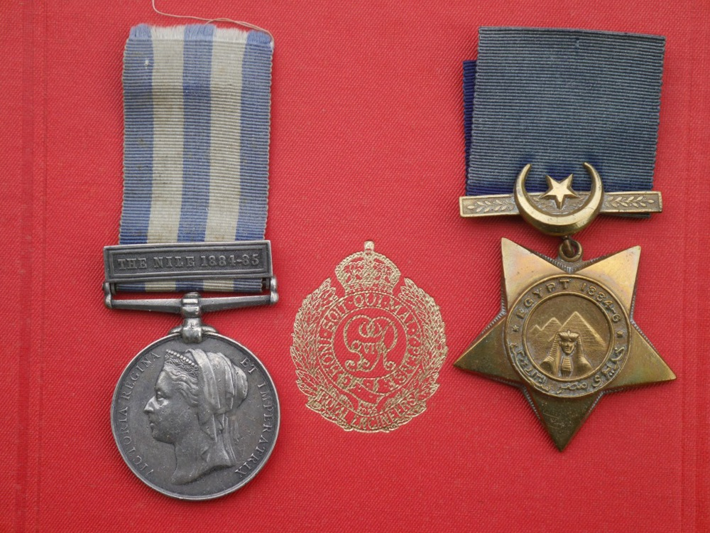 The two medals awarded to British soldiers and sailors - and some civilians, including Canadian voyageurs - who took part in the 1884-5 Nile expedition. The Nile Medal, awarded for actions from 1882-9, has the clasp awarded to Sapper Mark Wright for being present with the expedition; had he fought in the battles of Abu Klea or Kirbekan he would have had clasps for those actions as well. The Khedive's Star shown here was also awarded to a participant in the campaign, with the dates 1884-5 in the band. Struck by Jenkins of Birmingham, it also has the date in Arabic in the Muslim calendar below, and on the clasp the star and crescent of the Ottoman empire on whose behalf - officially, at least - the British were fighting.