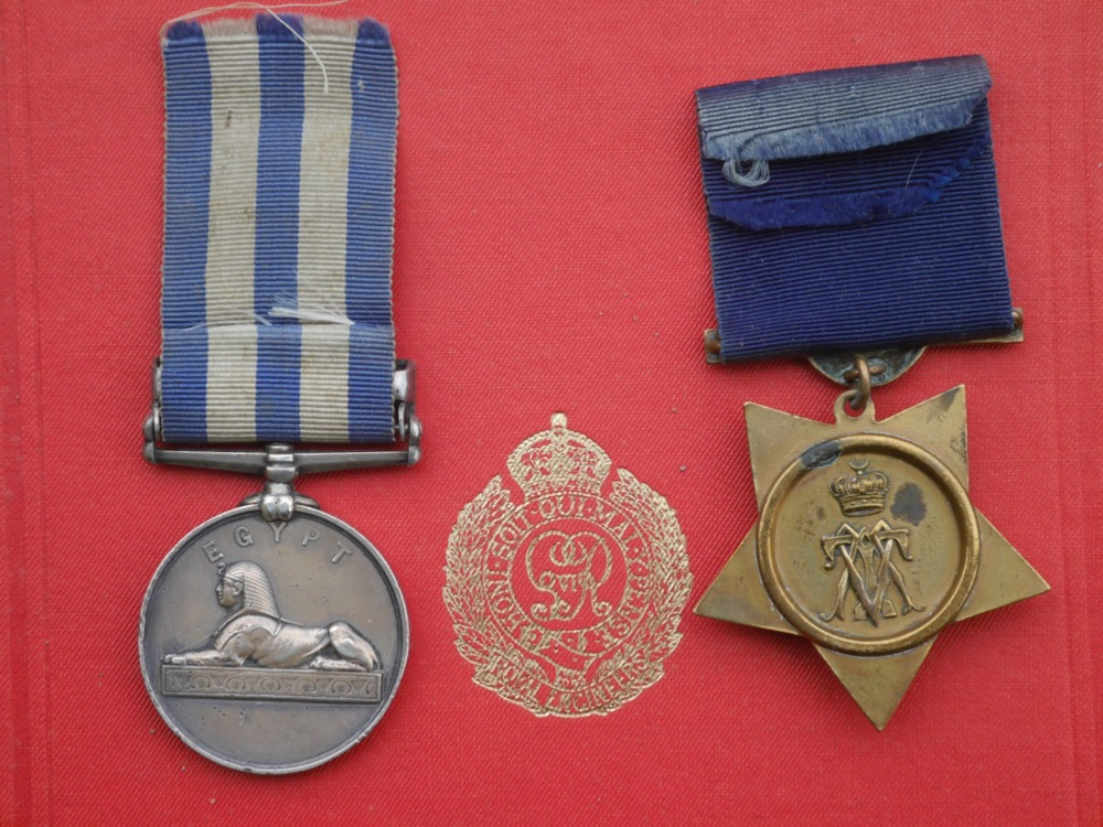 The reverse of the two medals shown above, placed on a copy of the official history of the Royal Engineers in the campaign with the R.E. emblem in between. The first version of the Nile medal, created for the Anglo-French intervention in Egypt in 1882, had that year beneath the Sphinx, but once the decision was made to award the medal for subsequent campaigns the space was left blank and the campaign date put in the clasp instead. The obverse of the Khedive's Star shows his monogram surmounted by a crown.