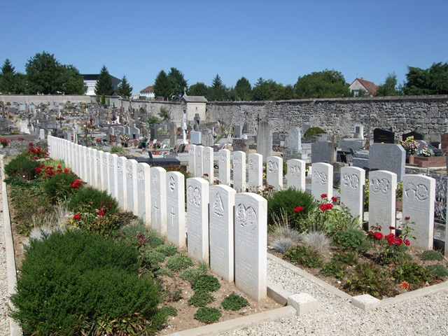 A view of the Commonwealth War Graves plot in Braine Communal Cemetery in northern France. 6878 Private Ernest Reginald Handford, 2nd Battalion, South Staffordshire Regiment, my mother's great-uncle, is commemorated on stone B8 – eighth from the left in the back row – along with a Lance-Serjeant of the 18th Hussars. The stones are 'Special Memorials' rather than headstones, because the exact positions of burials in this plot were lost some time after its use by No. 5 Casualty Clearance Station, based in Braine during the advance along the river Aisne when Ernest's battalion saw its first action in France.  The 'South Staffs' began the war with two regular battalions, numbering some 1600 men; by war's end the regiment had suffered 6,551 men killed. Ernest was 34, had been a filer in a bicycle factory before joining up, and left a wife and two small boys.