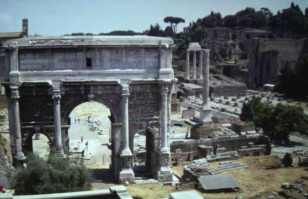 The view from the slope of the Capitoline hill that Aemilius Paullus would have had as he watched the triumphal procession coming along the Sacred Way towards him, only for us obscured by the arch of the emperor Septimius Severus at the head of the forum. In front of the arch are all of the most hallowed places of the forum, including the Rostra, and to the right in this picture are the remains of the Basilica Julia, three columns of the Temple of Vespasian and the foundations of the palatial structures on the Palatine Hill, all of which date later than the time of the triumph when the slopes of the Palatine were occupied by aristocratic houses.Venet's vantage point when he was planning his painting would have been about two hundred metres to the right of where I took this picture, allowing him to see the sequence of monuments visible in the background of his painting.