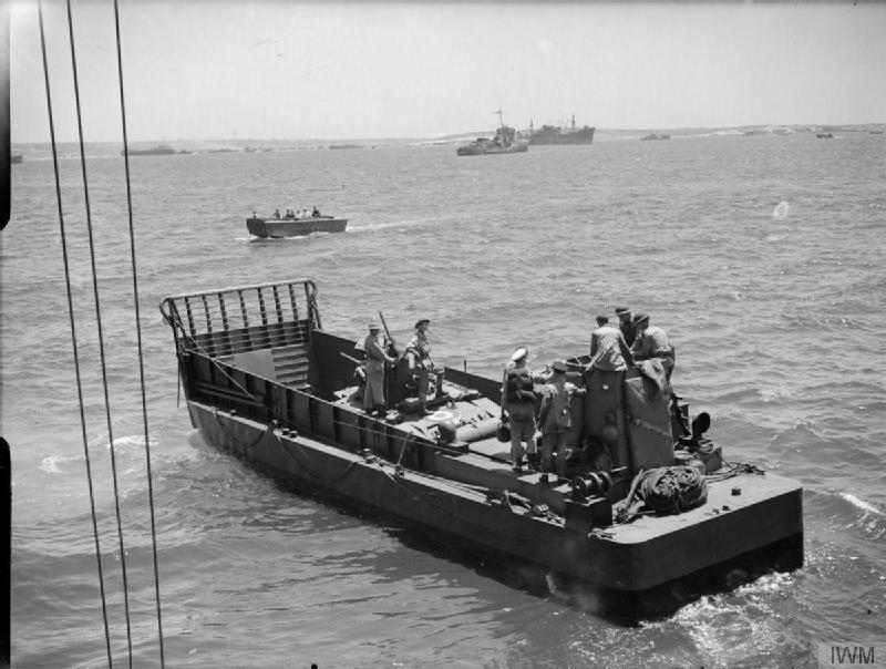 This photograph on the morning of the assault was taken by Lt H.A. Mason, R.N., an official Navy photographer, and shows an LCM (Landing Craft Mechanised), Mark 3. This is the first of a sequence of photos that Mason took beginning on HMS Hilary, the Force V HQ ship, and ending with him on shore. It was taken off 'Bark West' where the only LCM carrier was Empire Elaine, so this LCM had very probably been hoisted off her shortly before the picture was taken (Admiralty Official Collection, Imperial War Museum A 17955).