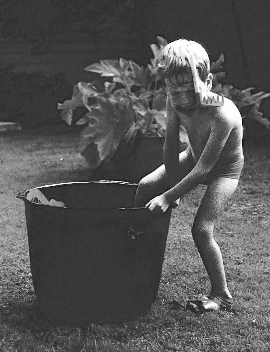 I couldn't wait to dive - a photo of me in New Zealand in the summer of 1966 aged three with cellophane mask, toy garden rake snorkel and rubber glove fins.