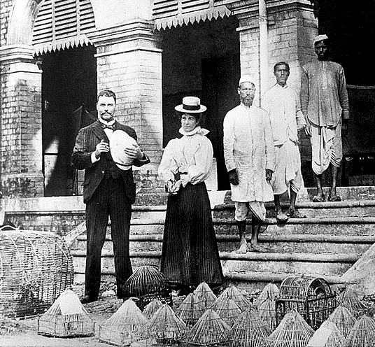 Surgeon-Major Ronald Ross with his wife and assistants outside the Calcutta laboratory where he carried out his research, photographed in 1898.